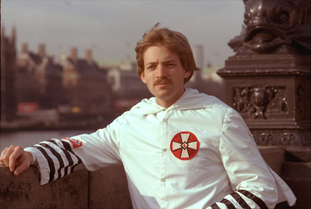 David Duke, 27-year-old Ku Klux Klan leader, poses in his Klan robes in front of the House of Parliament in London in March of 1978.  Although he was banned from entering Britain, he arrived here by way of a Skytrain flight from New York.  (AP Photo)