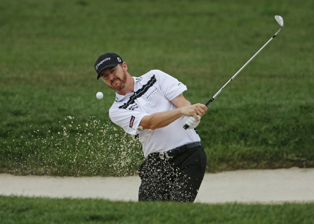 Jimmy Walker hits from a sand trap on the 10th hole during the third round of the PGA Championship on Sunday at Baltusrol Golf Club in Springfield, N.J.