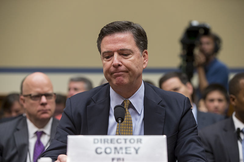 FBI Director James Comey pauses while testifying the House Oversight Committee on Thursday, July 7.