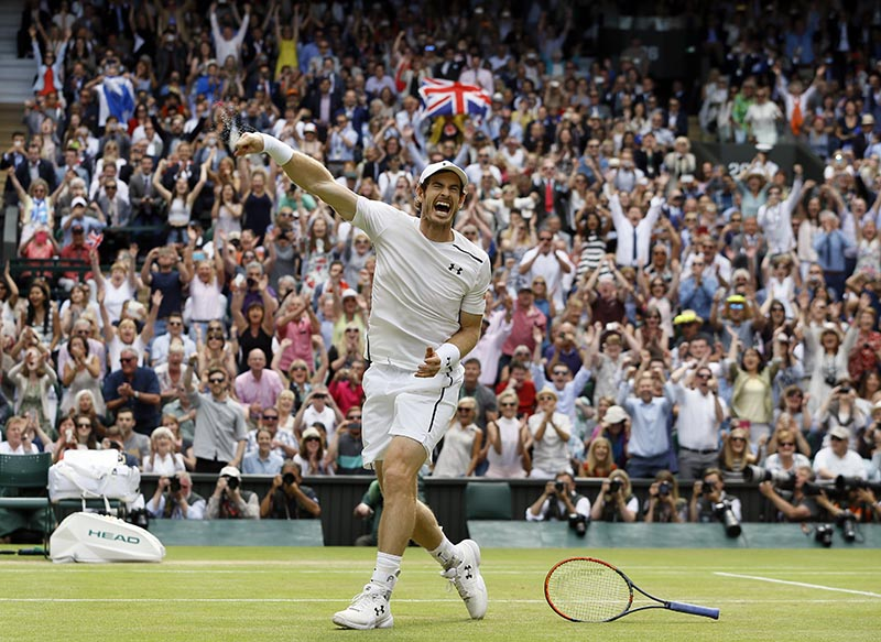 Andy Murray of Britain celebrates after defeating Milos Raonic of Canada.