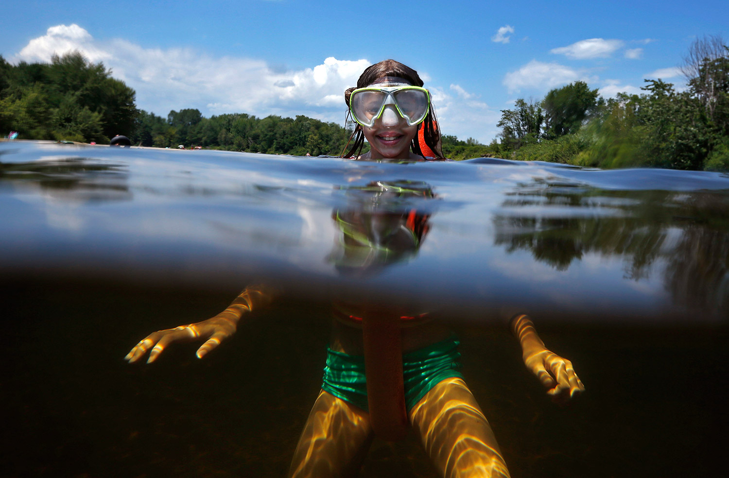 Emily Sword, of Fryeburg, keeps cool while floating in the Saco River on Wednesday in Fryeburg. With the temperature hovering around 90 degrees, swimming holes were popular spots.