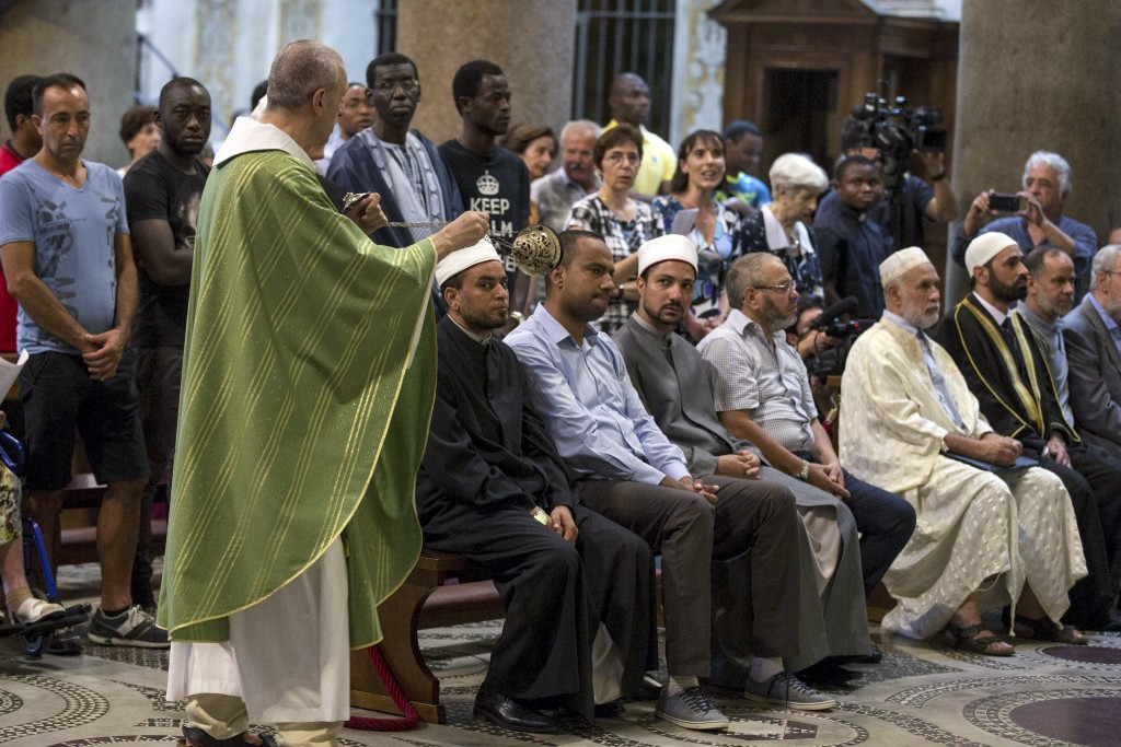Muslims attend a Mass in Rome's St. Mary in Trastevere church on Sunday.  Massimo Percossi/Ansa via AP