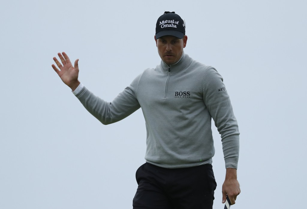 Henrik Stenson of Sweden acknowledges the crowd after putting and making a birdie on the 17th green during the third round of the British Open Golf Championship at the Royal Troon Golf Club in Troon, Scotland, on Saturday. AP Photo/Ben Curtis