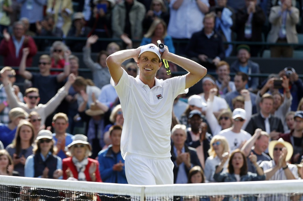 Sam Querrey of the U.S celebrates after beating Novak Djokovic of Serbia in their men's singles match on day six of the Wimbledon Tennis Championships in London, Saturday. Associated Press/Alastair Grant)