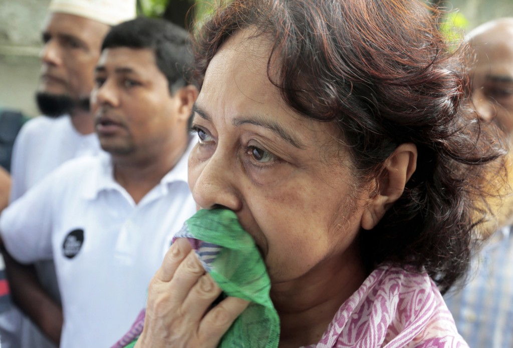 Hosne Ara Karim, whose son and daughter-in-law were rescued from the restaurant that was attacked by heavily armed militants, waits for them in Dhaka, Bangladesh, Saturday, after Bangladesh forces stormed the restaurant where militants held dozens of people hostage for 10 hours. Associated Press