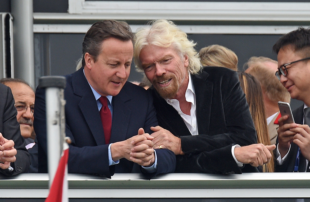 Britain's Prime Minister David Cameron and Virgin boss Richard Branson talk at the Farnborough International Airshow in Farnorough, south England, Monday. Andrew Matthews / PA via AP