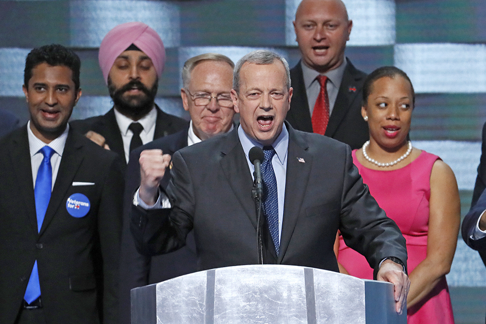 Gen. John Allen (Ret.) stands with veterans as he speaks during the final day of the Democratic National Convention in Philadelphia on Thursday. Scott Applewhite/Associated Press