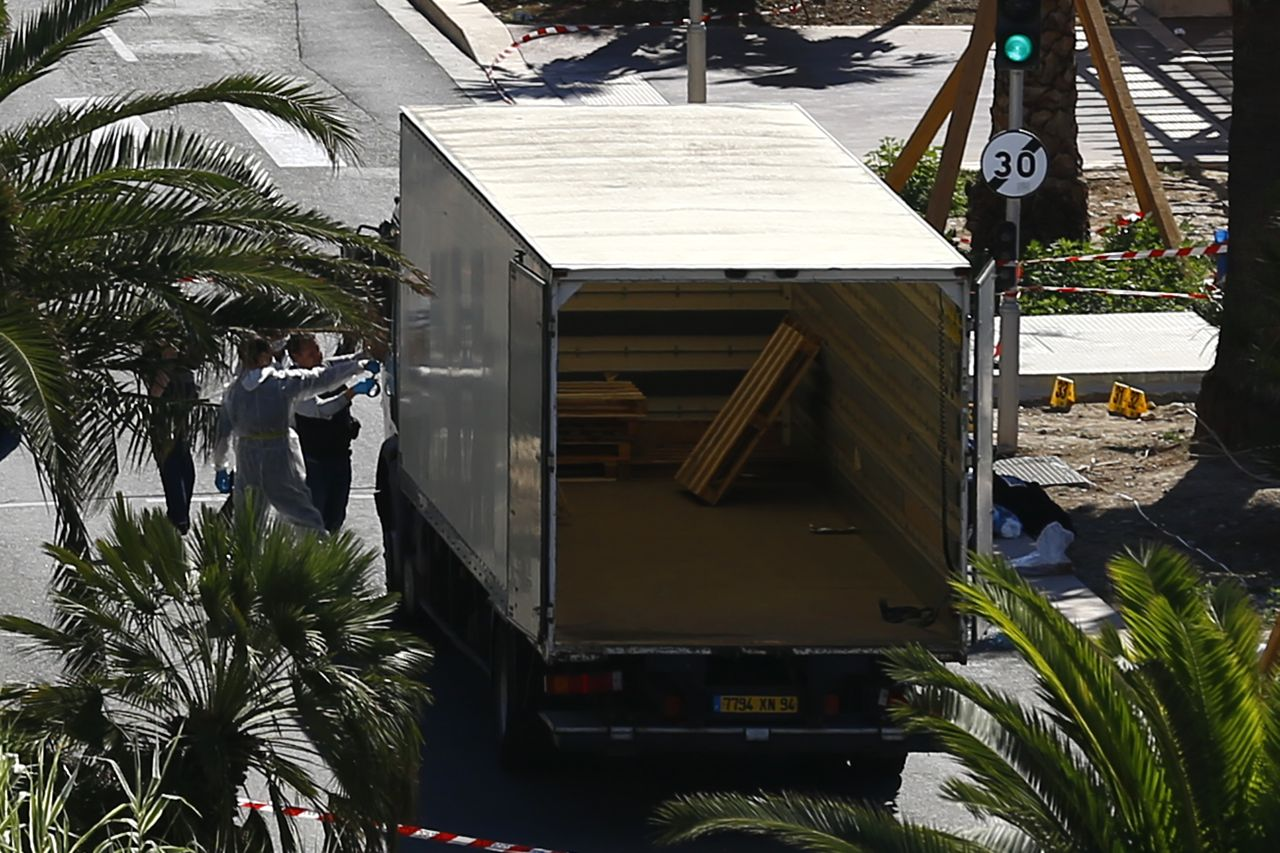 Investigators Friday examine the  truck that mowed through revelers in Nice, killing scores of people.