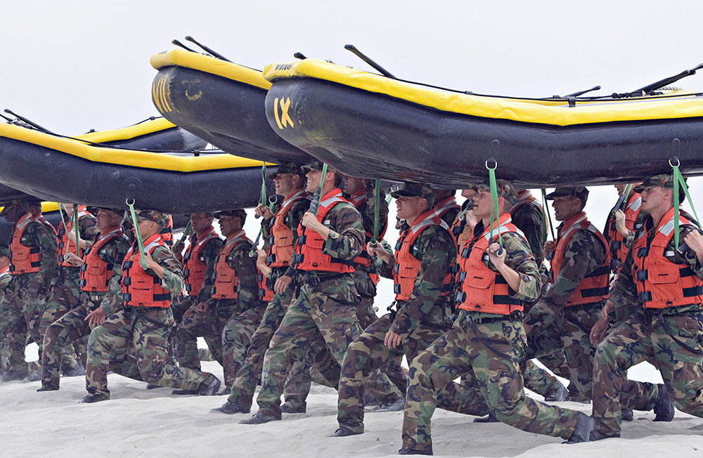 Navy SEAL trainees carry inflatable boats at the Naval Amphibious Base Coronado in Coronado, Calif. in May 2009. Denis Poroy/Associated Press