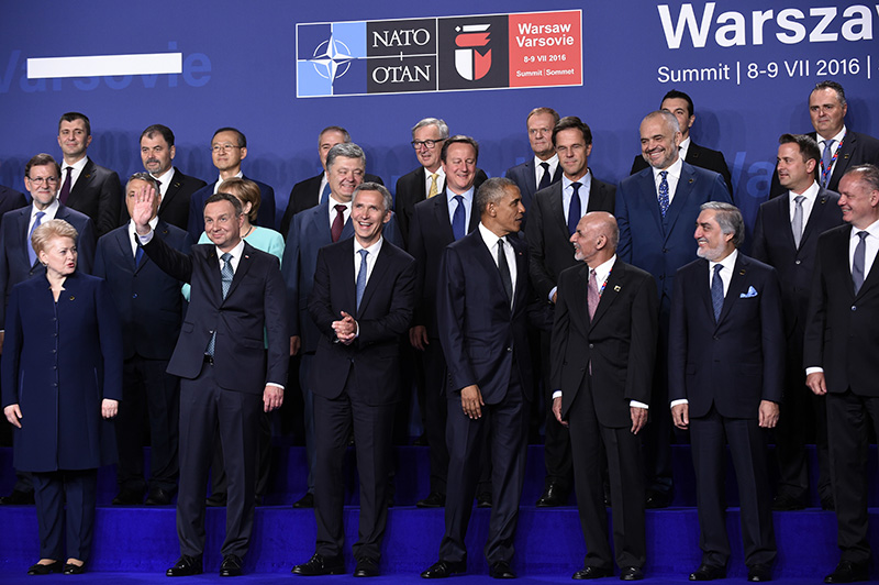 President Barack Obama, center, participates in a NATO family photo in Warsaw on Friday. Front row, from left are, Lithuanian President Dalia Grybauskaitė, Polish President Andrzej Duda, NATO Secretary General Jens Stoltenberg, Obama and Afghanistan's President Ashraf Ghani is right of Obama. Afghanistan's Chief Executive Dr. Abdullah Abdullah, second from right front.