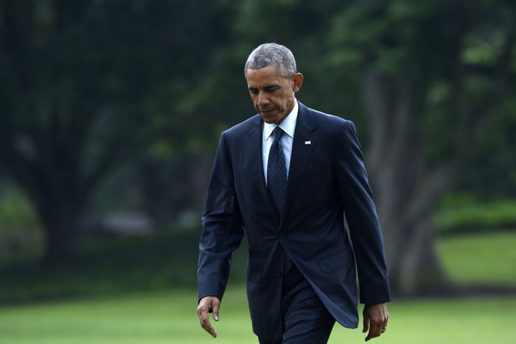 President Barack Obama returns from a trip to Orlando, Fla., on  June 16, 2016, where he consoled those mourning the deadliest mass shooting in modern U.S. history. While Obama continues to try to serve as bridge builder between white and black Americans, protesters and police, he also has had to face the limits of his rhetoric. Susan Walsh/Associated Press
