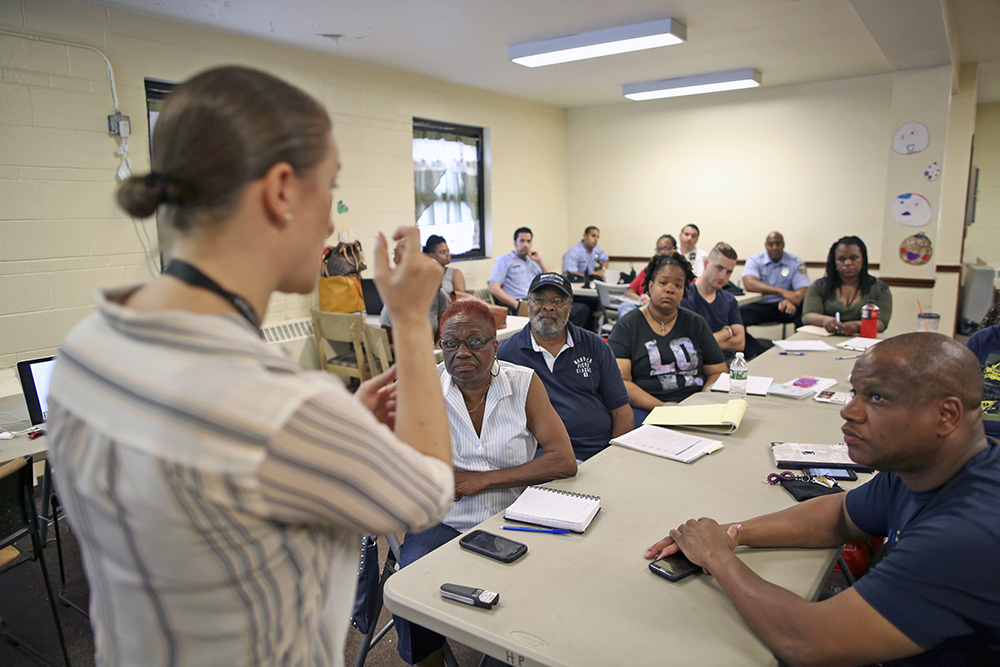 Dr. Zoe Maher, a Temple trauma surgeon, explains the Philadelphia Immediate Transport in Penetrating Trauma Trial to community leaders, at the Hunting Park Community Center, in Philadelphia. Joseph Kaczmarek/Associated Press