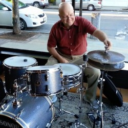 "Jazz drummer and composer Steve Grover gets ready to play at Elements cafe in Biddeford in June 2015. Paul Lichter, a jazz concert promoter, called Grover ""the most significant jazz musician in Maine history."""
