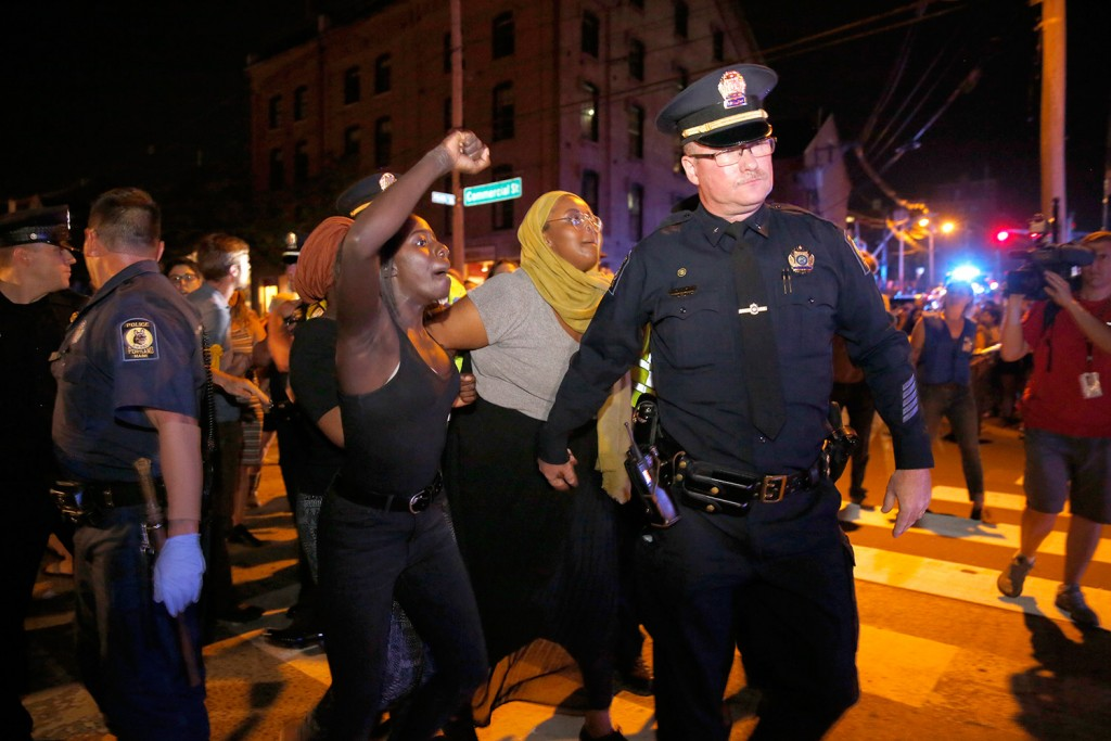 Police arrest Black Lives Matter protesters blocking Commercial Street in Portland on July 15. (Michele McDonald/Staff Photographer)