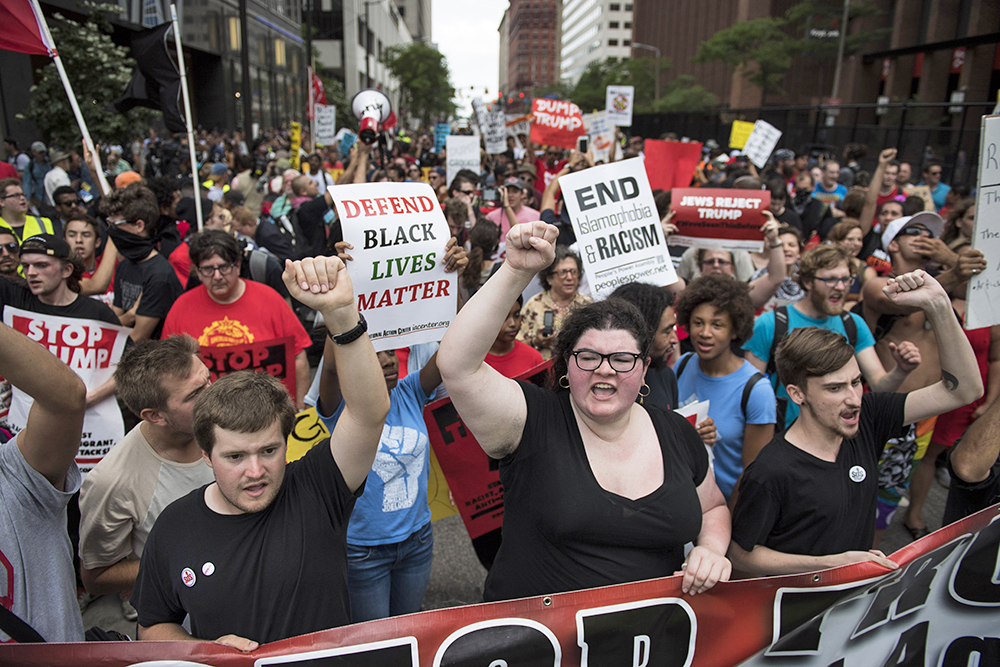 Anti-Trump demonstrators carry signs and yell as they march down the streets of downtown Cleveland on Monday. Washington Post photo by Jabin Botsford