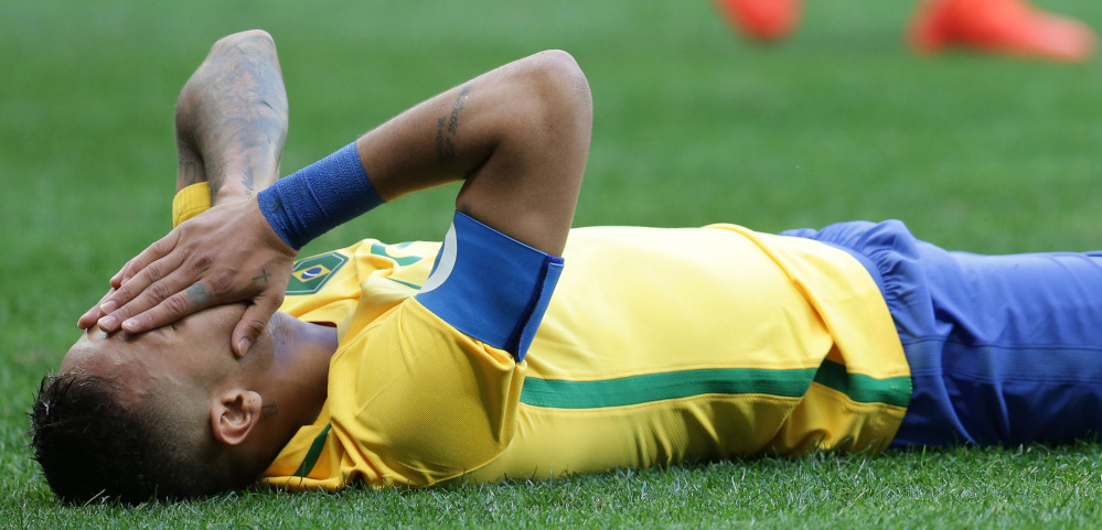 Neymar, one of the world's top young soccer players for Brazil, reacts Thursday after missing a chance during a scoreless tie with South Africa on the opening day of the men's tournament.