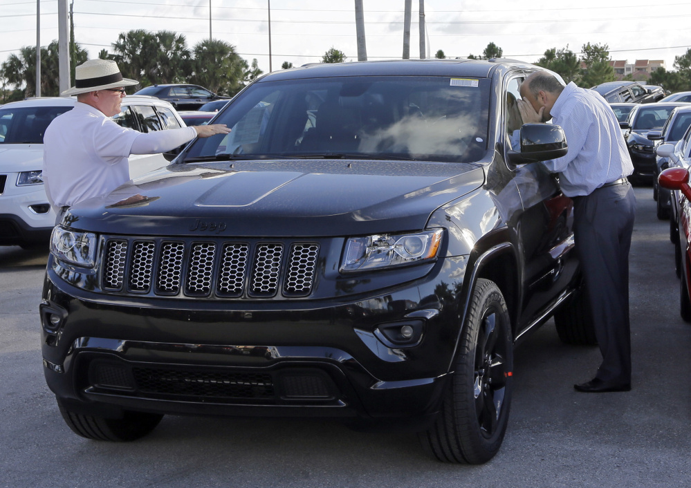 Vehicles like this Jeep Grand Cherokee attract big money on the black market in Mexico, authorities say. Two men jailed in Houston are accused of using pirated computer software to steal more than 100 vehicles. Such thefts are expected to increase around the world.