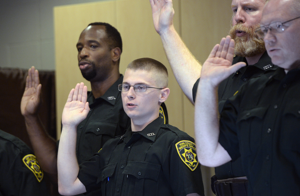 Chayce Steffiare, 21, of South Berwick is sworn in Friday as a York County Jail corrections officer. Staff shortages often mean mandatory overtime, which affects morale.