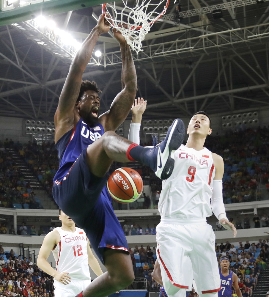 DeAndre Jordan adds a slam dunk over Zhai Xiaochuan of China, all part of an Olympics-opening 119-62 victory at Rio de Janeiro. The U.S. men will take on Venezuela in their second group game Monday.