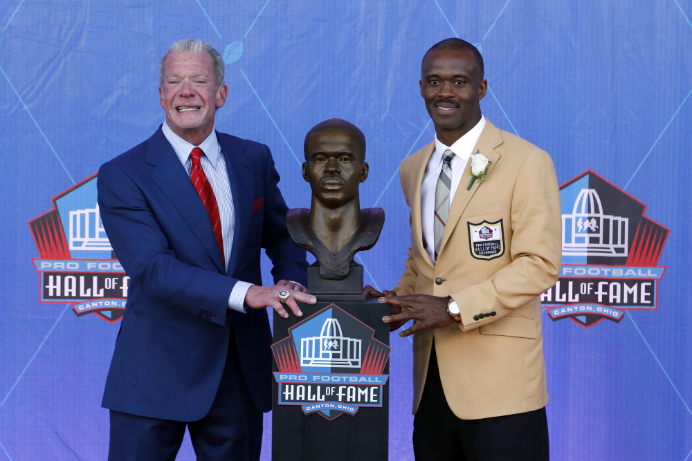 Former Indianapolis Colts wide receiver Marvin Harrison, right, poses with Colts owner Jim Irsay after Harrison was inducted into the Pro Football Hall of Fame on Saturday in Canton, Ohio.