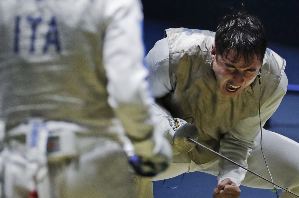 Alexander Massialas of the U.S. celebrates after beating Italy's Giorgio Avola in a foil fencing quarterfinal. Massialas later lost in the gold-medal match.