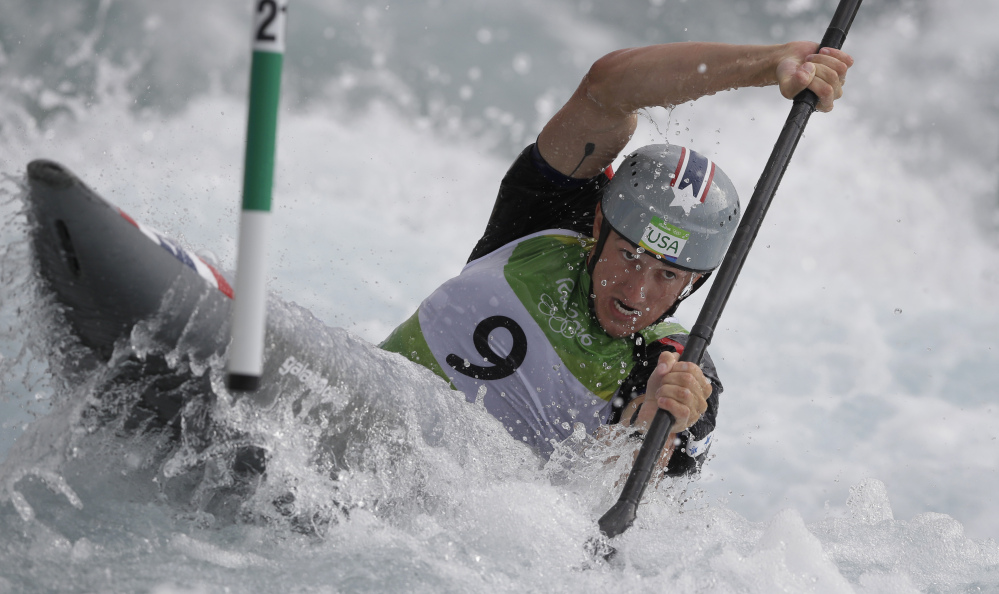 Michal Smolen of the United States steers through a gate during the kayak K1 men's heats. Smolen posted the 10th-best score and advanced to Wednesday's semifinals.