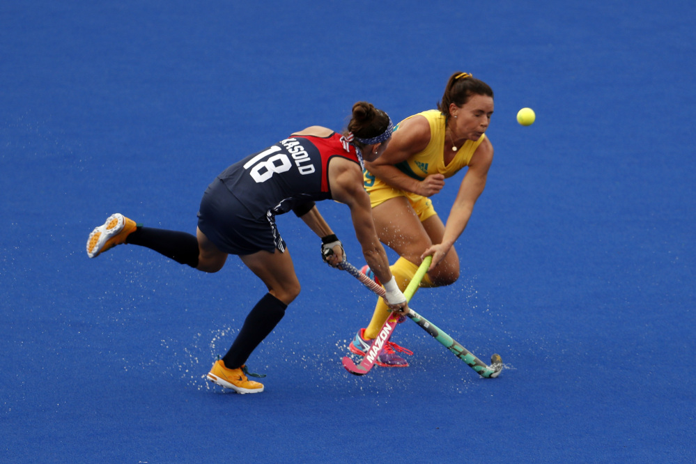 The United States' Michelle Kasold, left, fights for the ball with Australia's Georgie Parker during a women's field hockey match Monday in Rio de Janeiro