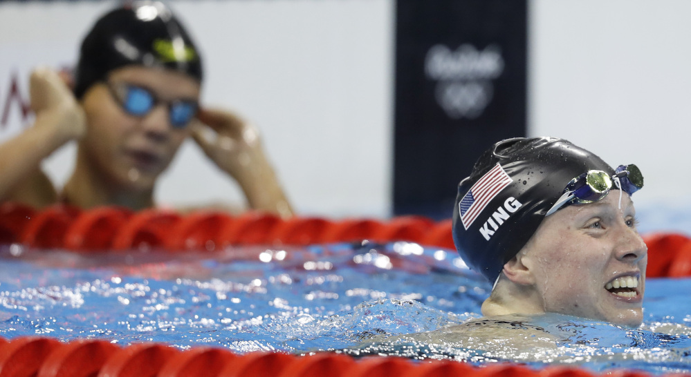 Russia's Yulia Efimova, left, looks on as Lilly King celebrates winning the gold medal in the women's 100-meter breaststroke Monday in Rio de Janeiro.