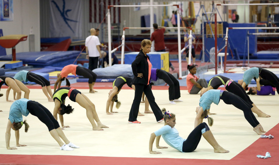 Martha Karolyi, national team coordinator for USA Gymnastics, watches over gymnasts during a training session at the Karolyi Ranch, in New Waverly, Texas, last September.