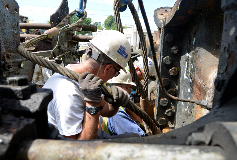 Volunteers from New England Steam Corporation prepare to move Old 470 from its spot at the rail yard on College Avenue in Waterville.