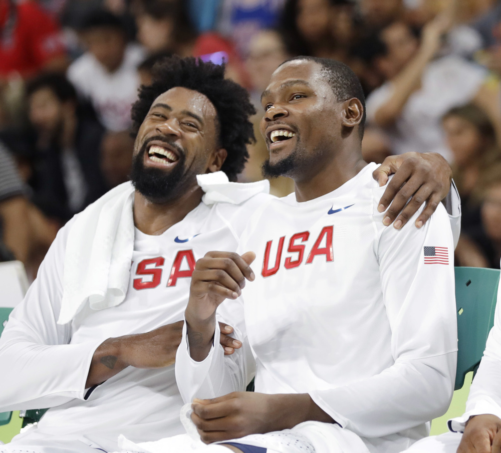 DeAndre Jordan, left, jokes with Kevin Durant, during the United States men's basketball team's 113-69 win over Venezuela on Monday in Rio de Janeiro.