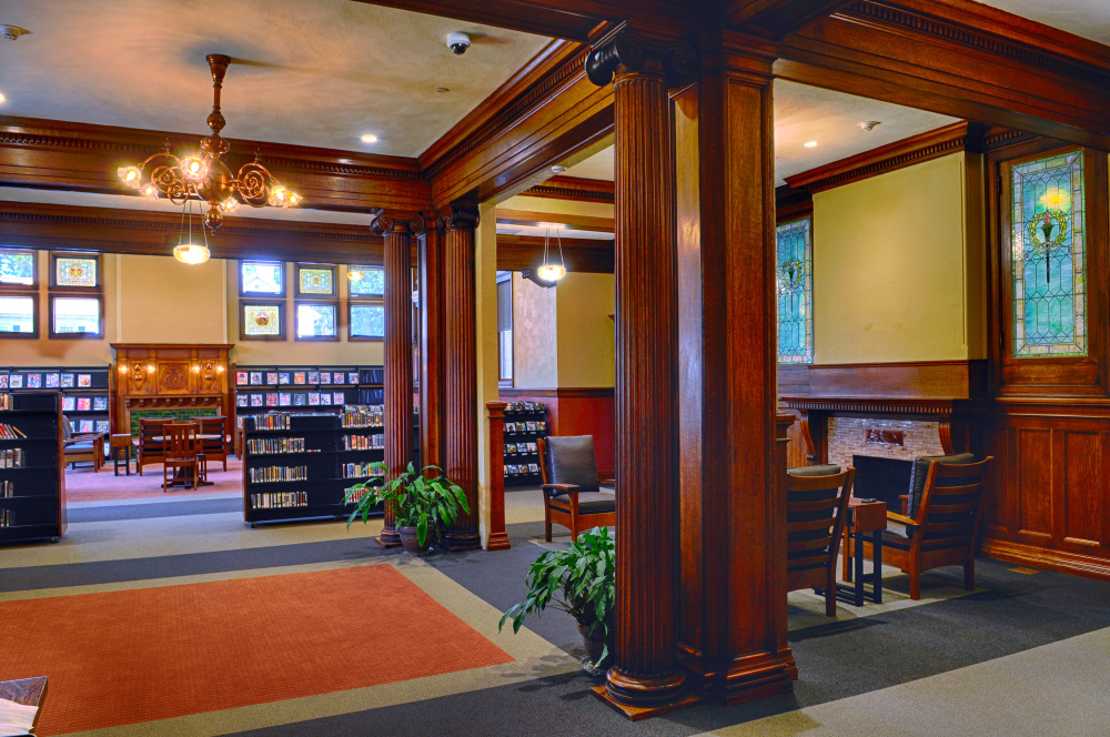 This fireside lounge, shown Tuesday, occupies the spot where the circulation desk of Augusta's Lithgow Public Library stood before its recent renovation and expansion. A painting of namesake Llewellyn Lithgow will be hung before the library reopens on Saturday.