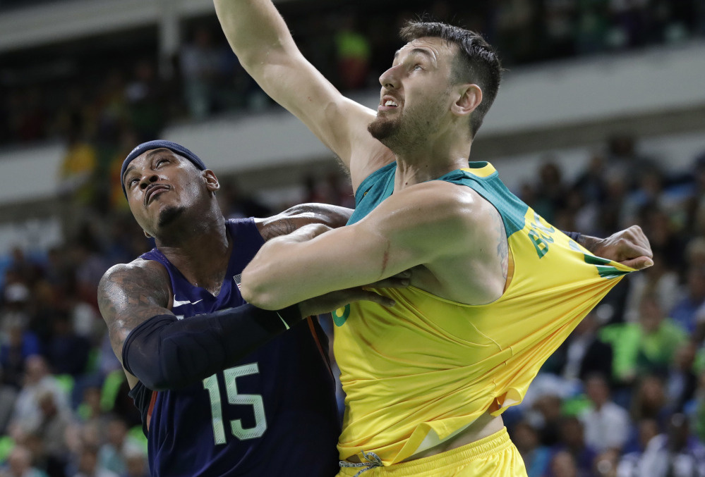 Carmelo Anthony of the U.S. (15) and Australia's Andrew Bogut (6), both NBA players, jockey for position during Wednesday's game. Anthony became the all-time leading U.S. scorer in the Olympics during the game.