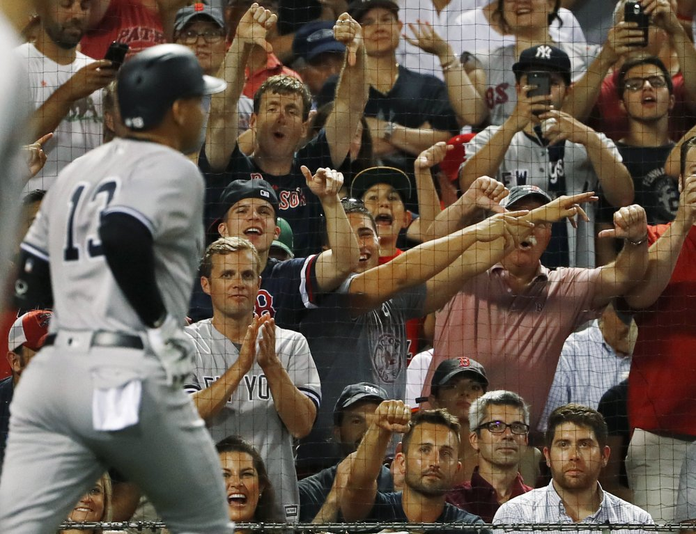 Alex Rodriguez gets an earful from the Boston fans as he heads back to the dugout after flying out as a pinch hitter in the seventh inning Wednesday night. Rodriguez is playing in his last series in Boston.