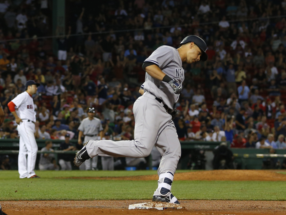 The Yankees' Gary Sanchez rounds the bases after hitting a home run off Red Sox reliever Junichi Tazawa in the eighth inning of New York's 9-4 win Wednesday night. Boston led 4-1 at one point. It was Sanchez's first major league home run.