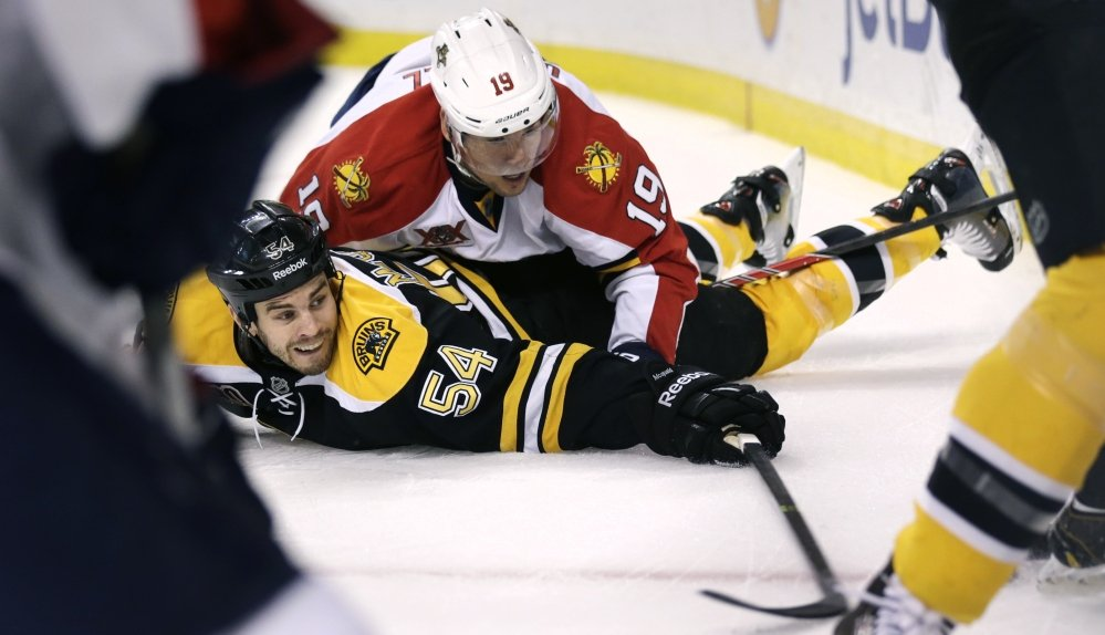 Boston defenseman Adam McQuaid, bottom, was able to spend more time upright this offseason – his first in three years in which he did not have to have surgery of one type or another.