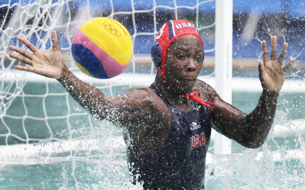 Ashleigh Johnson of the United States attempts to stop the ball Thursday during the 12-4 victory against China in women's water polo. Including the Olympics, the U.S. has an 18-game winning streak.