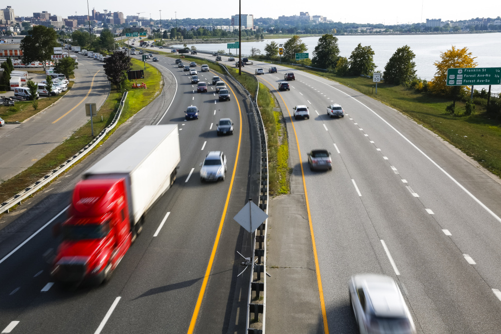 Travelers move through Portland on Interstate 295, where heavy traffic can make commuting to work a hassle.