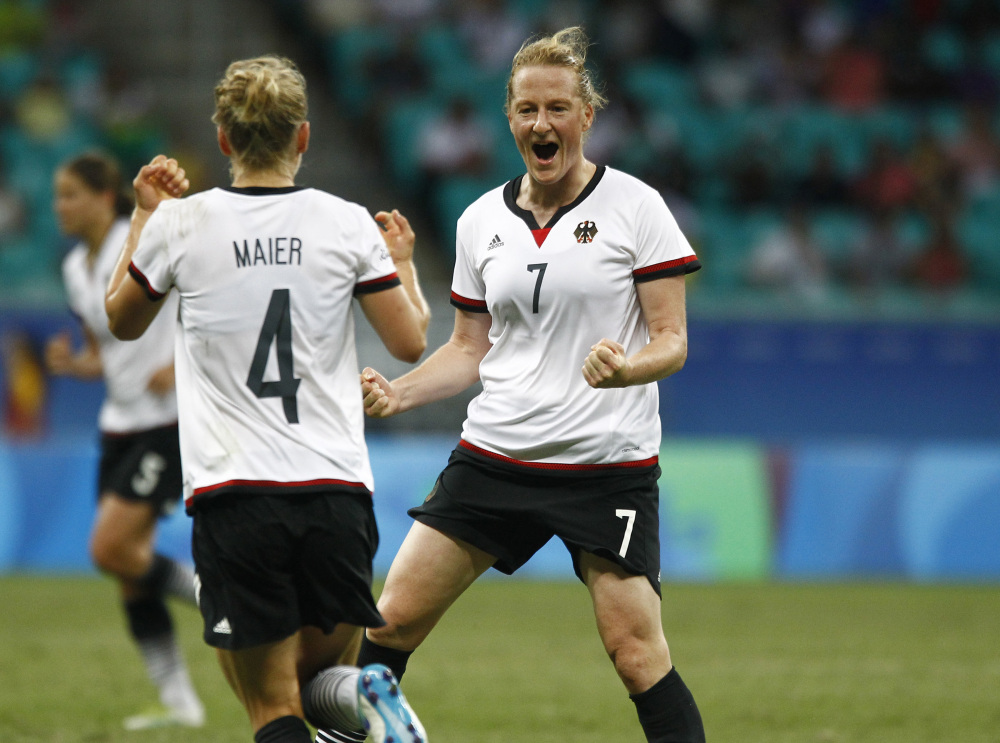 Germany's Melanie Behringer, right, celebrates her goal with teammate Leonie Maier during their quarterfinal match Friday against China. The goal proved to be the game winner and Germany advanced to the Olympic semifinals.