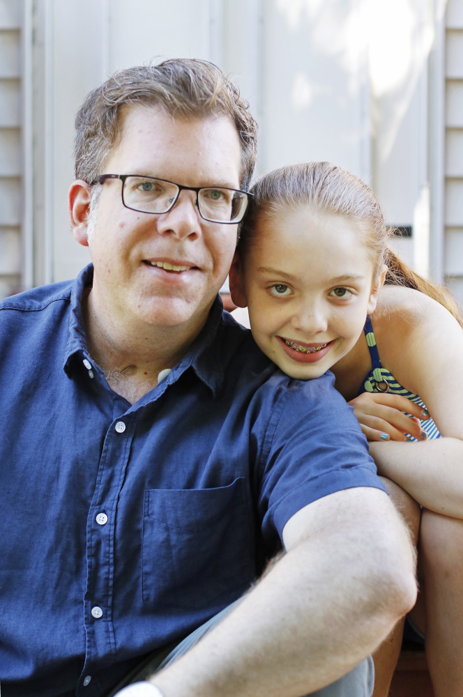 Jason Crigler sits with his daughter, Ellie, 11, at home in South Berwick. (Photo by Jill Brady/Staff Photographer)