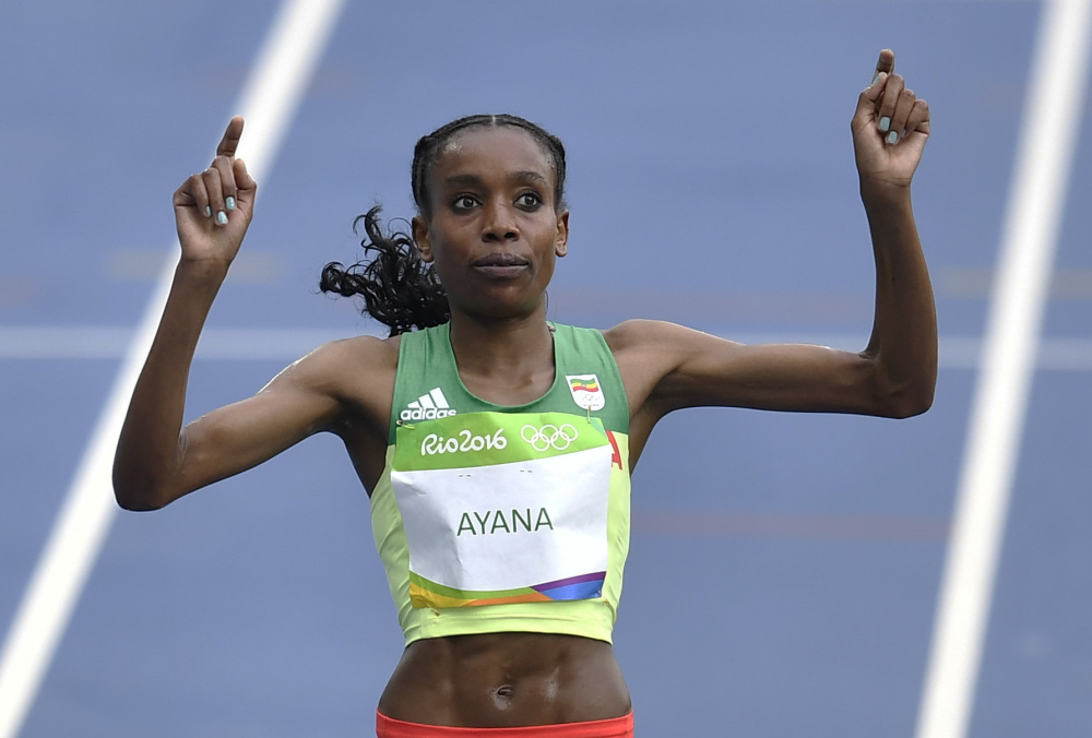 Ethiopia's Almaz Ayana celebrates winning the women's 10,000-meter final during the 2016 Summer Olympics at Rio de Janeiro, on Friday. Associated Press/Martin Meissner