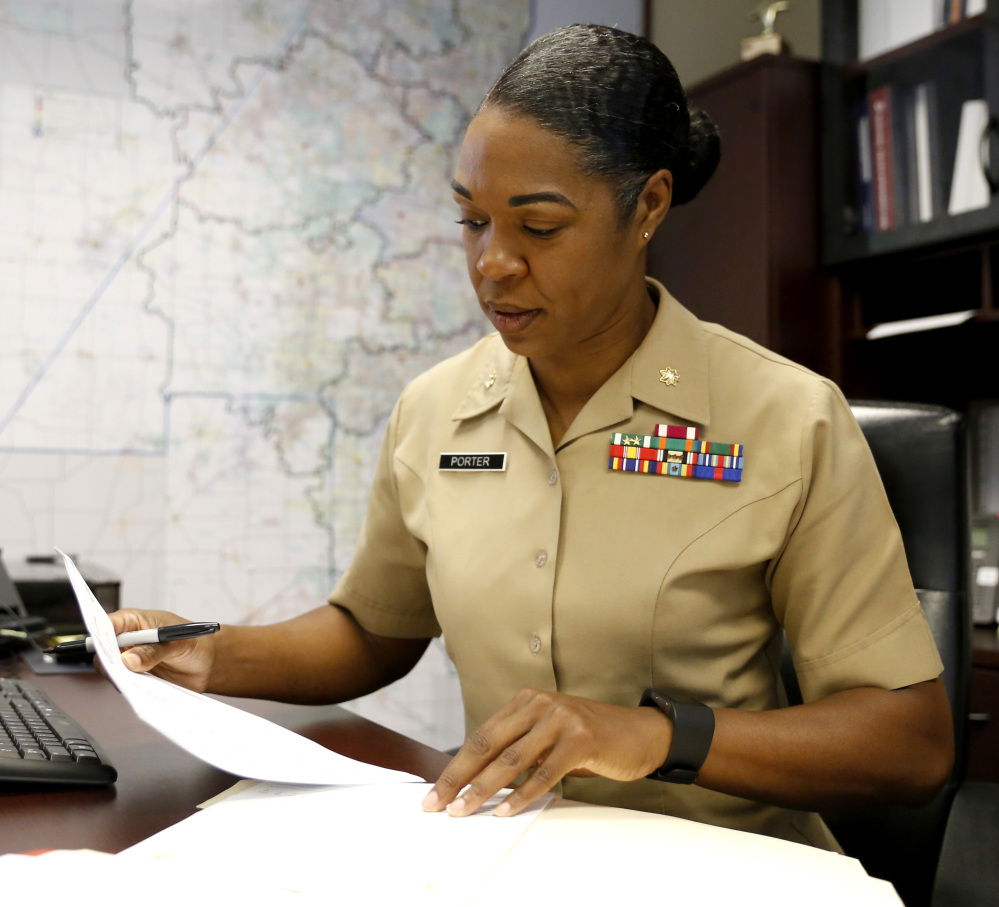 Maj. Shanelle Porter, commanding officer at the Recruiting Station Chicago works in her office in Des Plaines, Ill. Women who want front-line roles, she said, wish to be pioneers.