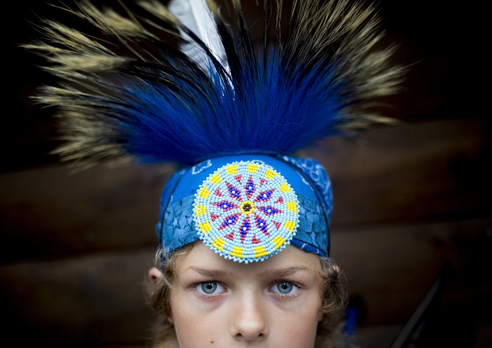Robert Allen, 10, at the Attean Family Pow Wow at Maine Wildlife Park. Allen and his family traveled from New Hampshire to the pow wow, held on Saturday, August 13, 2016.
