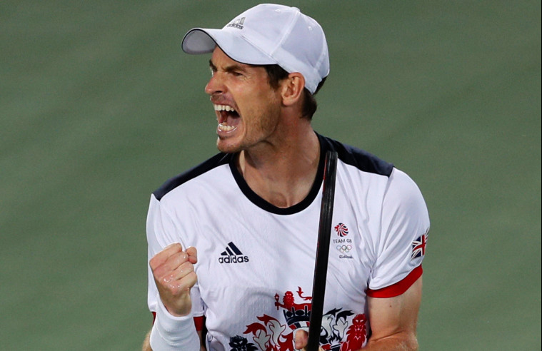 Andy Murray of Great Britain screams after winning the first set against Juan Martin del Potro of Argentina in the gold medal match of the men's singles tennis competition at the 2016 Summer Olympics in Rio de Janeiro, Brazil, on Sunday.