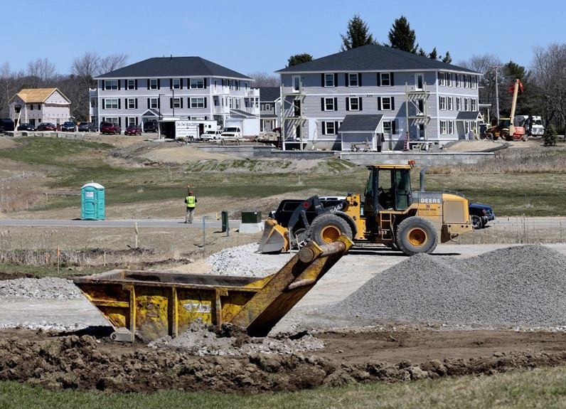 Apartments under construction at Blue Spruce Farm in Westbrook in April. <em>Derek Davis/Staff Photographer</em>