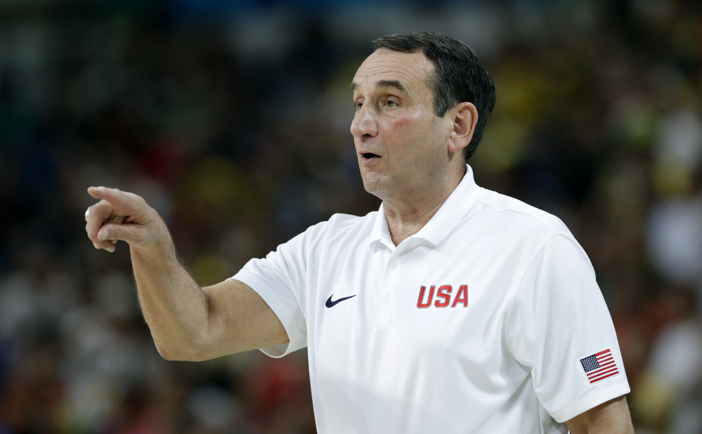 Mike Krzyzewski directs his team during a basketball game against France in Brazil.
