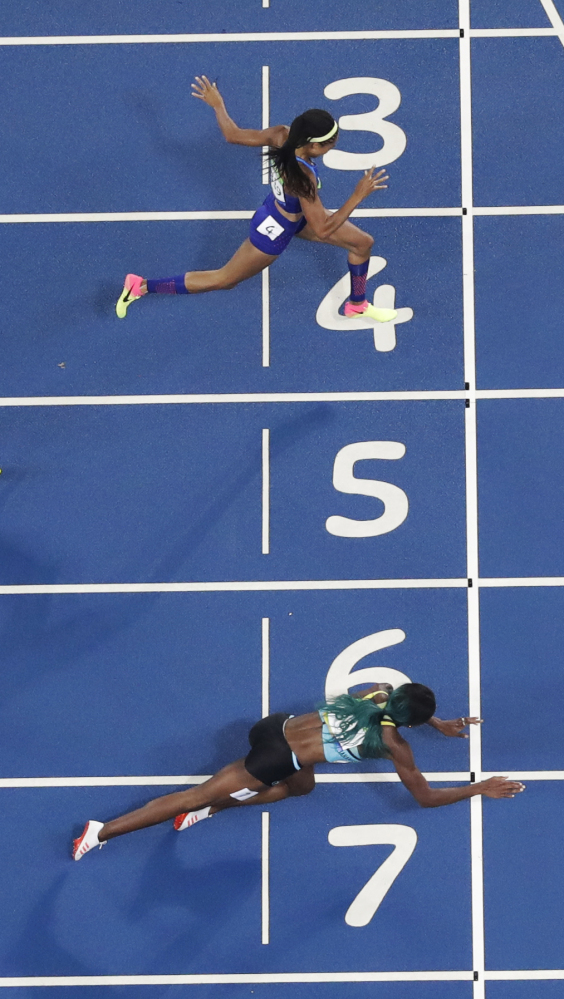 Associated Press/Matt Slocum In this overhead shot, Shaunae Miller of the Bahamas dives across the finish line ahead of Allyson Felix of the U.S. to win the gold medal in the 400 meter finals.