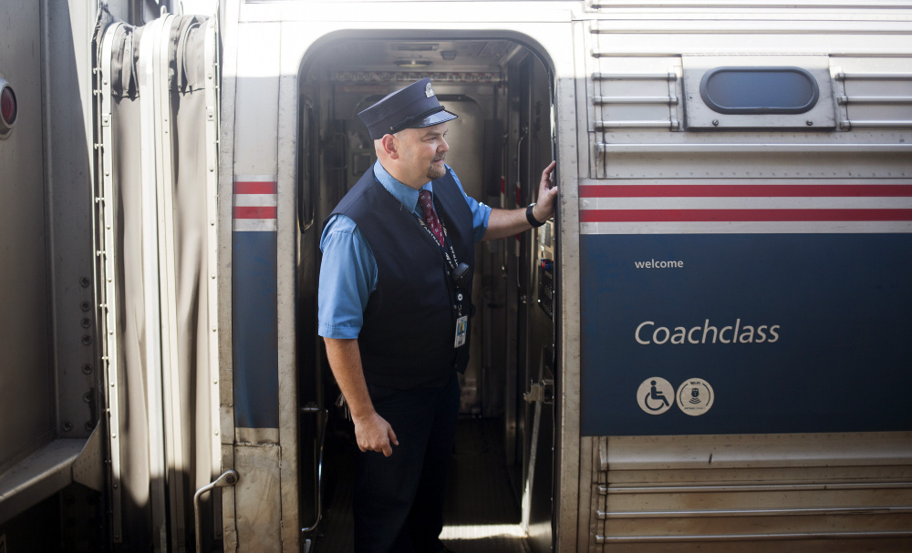 Chuck Moyer, a conductor who has been with Amtrak for 27 years, looks out along the train at the Brunswick stop Friday. The Amtrak Downeaster's  $9.3 million Royal Junction Siding project is expected to begin next year.