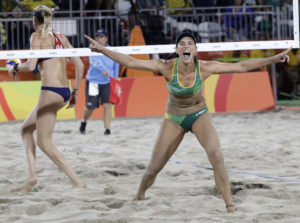 Brazil's Agatha Bednarczuk celebrates winning a point during a women's beach volleyball semifinal match against United States at the 2016 Summer Olympics in Rio de Janeiro, Brazil, on Wednesday.