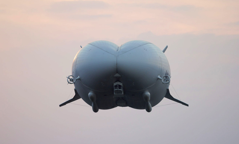 Considered the world's largest aircraft, the 302-foot Airlander 10 takes off Wednesday in central Britain.